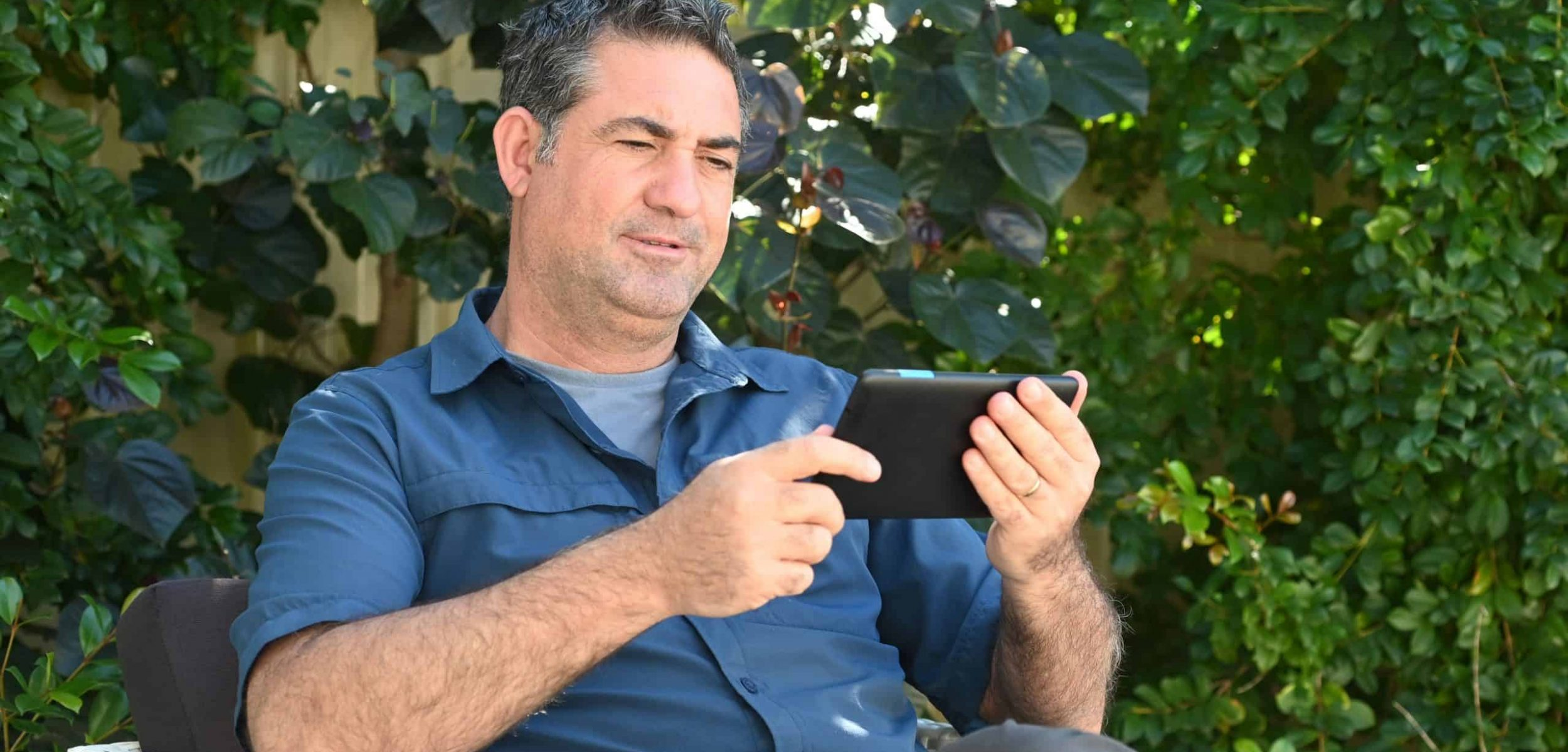 Relaxed,Mature,Adult,Man,(age,40-50),Reading,Or,Watching,Video